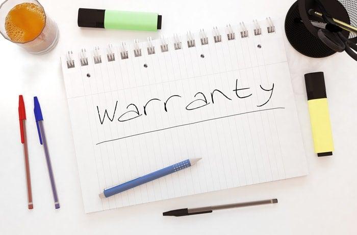 warrantyと書いてあるメモ帳とペン