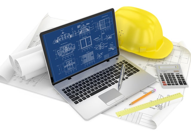 パソコンと設計図とヘルメットと電卓